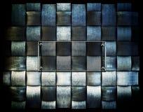 Una placa metálica del fondo Imagen de archivo