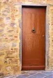 Una porta di legno Immagine Stock
