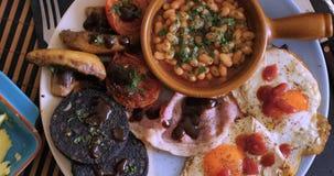 Una prima colazione inglese in pieno cucinata Fotografie Stock Libere da Diritti