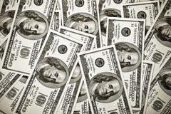 una priorità bassa delle 100 banconote del dollaro Immagini Stock