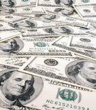Una priorità bassa delle cento banconote Fotografia Stock