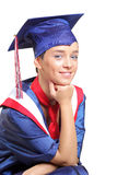 Una protezione e un abito da portare felici dell'allievo di laurea Immagine Stock Libera da Diritti