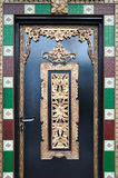 Una puerta de la maneta palanca con diseño florido Fotografía de archivo libre de regalías