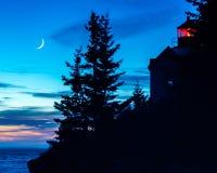 una puesta del sol de la silueta de Bass Harbor Healight House fotografía de archivo
