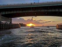 Una puesta del sol del canotaje Imagen de archivo libre de regalías