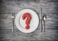 Una questione di carne, carne tritata come punto interrogativo fotografia stock libera da diritti