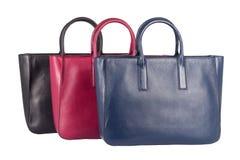 Una raccolta della borsa femminile di cuoio naturale tre Immagini Stock