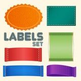 Una raccolta di cinque etichette o distintivi variopinti dello spazio in bianco Fotografia Stock Libera da Diritti