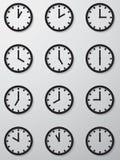 Una raccolta di 12 ore di orologio di icona del fronte. Fotografia Stock Libera da Diritti
