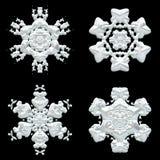 Una raccolta di quattro dei fiocchi di neve decorazioni di inverno sul nero royalty illustrazione gratis