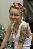 Una ragazza al festival del tatuaggio di St Petersburg Fotografia Stock Libera da Diritti