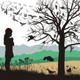 Una ragazza ammira gli uccelli Fotografia Stock
