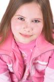 Una ragazza bionda graziosa di dieci anni che osserva in su fotografia stock