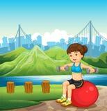 Una ragazza che fa il suo corpo misura vicino al fiume Immagine Stock