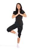 Una ragazza che fa yoga Fotografia Stock