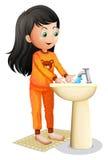 Una ragazza che lava le sue mani Immagine Stock Libera da Diritti