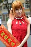 Una ragazza cinese celebra il nuovo anno cinese Fotografia Stock
