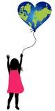Una ragazza con l'aerostato del mondo Fotografie Stock