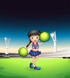 Una ragazza pon pon che esegue nella corte di calcio Immagini Stock