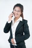 Una ragazza sorridente di affari in vetri Immagini Stock