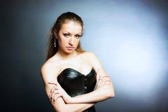 Una ragazza in un corsetto Fotografie Stock