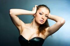 Una ragazza in un corsetto Fotografia Stock Libera da Diritti