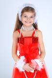 Una ragazza yoing con sorridere del regalo di Natale Fotografia Stock