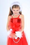 Una ragazza yoing con sorridere del regalo di Natale Fotografie Stock Libere da Diritti