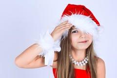 Una ragazza yoing con sorridere del regalo di Natale Immagini Stock