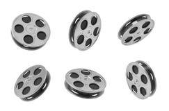 una rappresentazione 3d di sei bobine di nastro nere di film negli angoli differenti su fondo bianco illustrazione di stock