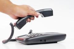 Una recolección manual a mano encima de un teléfono Fotografía de archivo libre de regalías