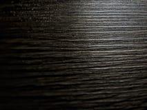 Una reflexión borrosa de la luz brilla en el piso de madera Imagen de archivo libre de regalías