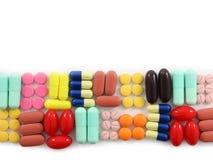 Una riga delle pillole fotografie stock libere da diritti