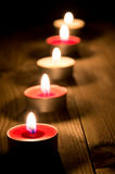 Una riga di candele burning Immagine Stock