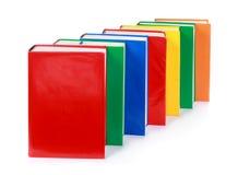 Una riga di molti libri variopinti in bianco Fotografia Stock