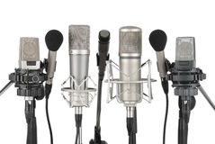 Una riga di sette microfoni Fotografia Stock Libera da Diritti