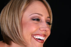 Una risa de las mujeres Imagen de archivo libre de regalías