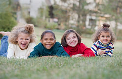 Una risata dei quattro bambini Fotografia Stock