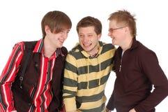 Una risata felice dei tre amici Fotografie Stock Libere da Diritti