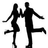 Una roccia di dancing dell'uomo e della donna delle coppie Immagini Stock