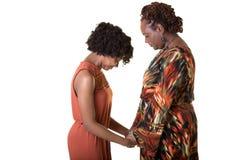 Una rogación de la madre y de la hija Imagenes de archivo
