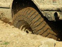 Una rueda adentro el fango Foto de archivo libre de regalías
