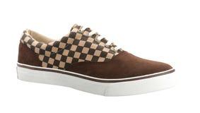 Una scarpa da tennis variopinta della tela di canapa Fotografia Stock