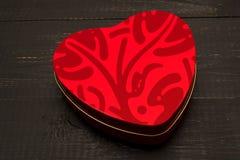 Una scatola di cioccolato in un cuore Fotografie Stock Libere da Diritti