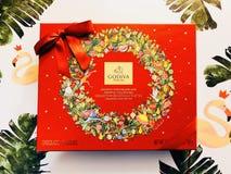 Una scatola di regalo di cioccolato di Godiva fotografie stock libere da diritti