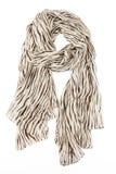 Una sciarpa è beige di seta con i corsi di fasciame messi insieme su un nodo Fotografia Stock