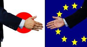 Una scossa dell'uomo di affari mano, il Giappone e UE Immagini Stock Libere da Diritti