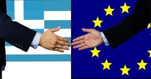 Una scossa dell'uomo di affari mano, la Grecia e UE Fotografie Stock