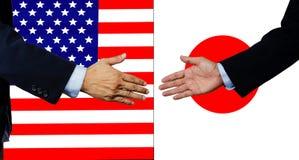 Una scossa dell'uomo di affari mano, U.S.A. ed il Giappone Fotografia Stock Libera da Diritti