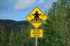 Una señal de peligro para los motoristas foto de archivo libre de regalías